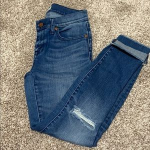 MADEWELL jeans with knee rip details and raw hem